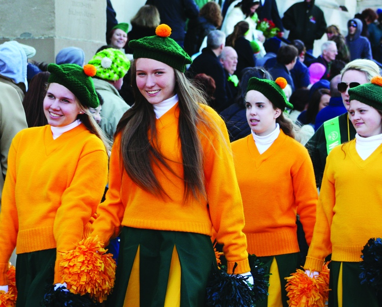 PHOTO BY CHUCK HOVEN Monday, March 17, 2014, St. Colman Church, 2027 W. 65th Street: Ready to march in the St. Patrick's Day Parade on a crisp and cold wintry day, these colorfully dressed young women head down W. 65th after attending the St. Patrick's Day Mass at St. Colman Church.