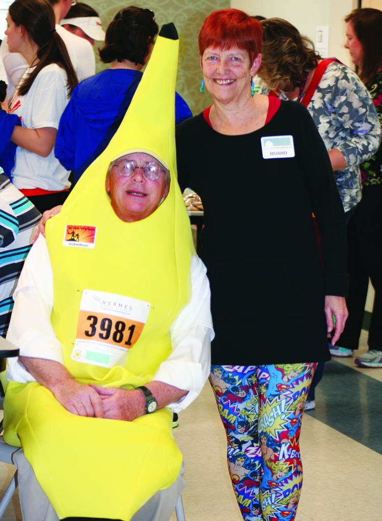 PHOTO BY CHUCK HOVEN Saturday, April 12, 2014; Be Your Own Hero 5KRace and 1 mile run, West Side Community House, W. 93rd and Lorain Avenue: Husband and wife, West Side Community House Volunteer Tom Buford dressed as a banana with West Side Community House Board member, Diane Fedak.