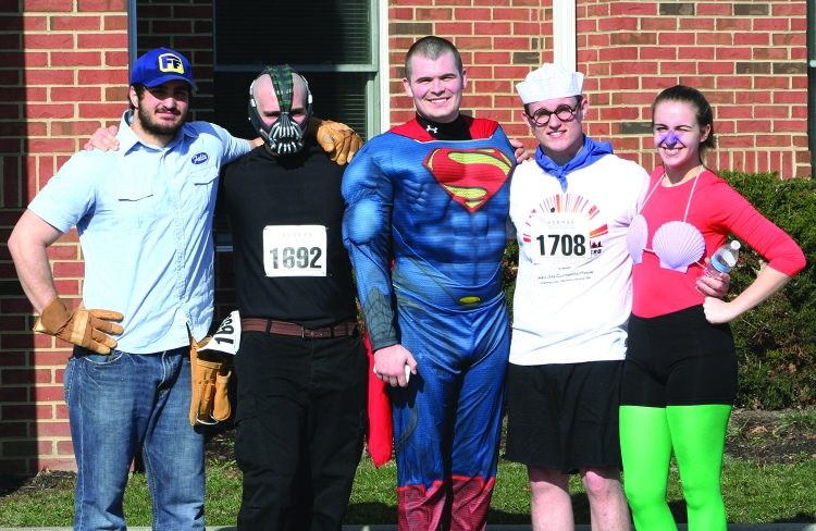PHOTO BY CHUCK HOVEN Saturday, April 12, 2014; Be Your Own Hero 5KRace and 1 mile run, West Side Community House, W. 93rd and Lorain Avenue: Many of the runners dressed as superheroes for the race. Here are Ziad Akel as Fix It Felix, the winner of the most creative costume; Ramzi Akel as Bane; David Budertscher as Superman, and the winners of the most colorful costume -- the team Brian Dawson as Barnacle Boy and Courtney Dawson as Mermaid Man.