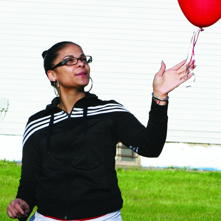 "PHOTO BY CHUCK HOVEN Tuesday, May 6, 2014; Missing Persons Awareness Day on Seymour Ave., 1-year anniversary of escape on Seymour Ave: Irene Garcia releases a balloon saying she wants to show her support for those that were held captive here and express her appreciation of the strength they have shown. Garcia, who lives in the West Boulevard neighborhood near where Amanda Berry and Gina DeJesus were abducted, says, ""If it were my girls, I know I would never give up looking. Gina's Mom gave me a lot of inspiration. I will admire her forever."""