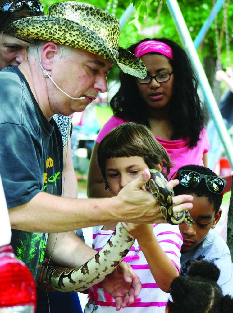 PHOTO BY CHUCK HOVEN Sunday, June 1st, 2014; West Park Summerfest, Jefferson Park, Lorain Avenue between W. 133 & W. 134th Streets: Children gather around Jungle Bob Tuma for a chance to get up close to a large snake.