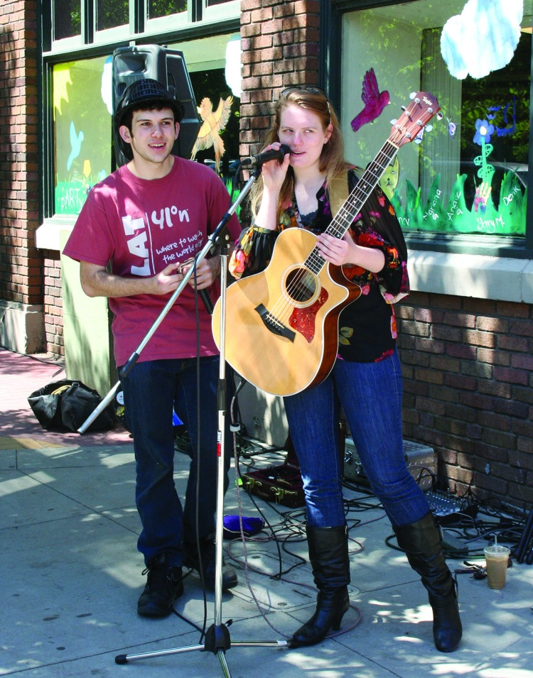 PHOTO BY DEBBIE SADLON Saturday, June 14, 2014; Party in Gordon Square, W. 65th & Detroit Avenue: Jarred Goldweber and Taylor Lamborn join in providing musical entertainment. The pair of local musicians say they have played together before at jam sessions held weekly at the Parkview (Wednesday nights at 10 p.m.) and at Brother's Lounge (Thursday nights at 9 p.m.).