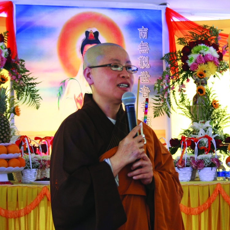 PHOTO BY CHUCK HOVEN Sunday, July 20, 2014; Celebration of 10th Anniversary of Quan Am Buddhist Temple, 11921 Bellaire Road: Quan Am Temple Abbess Venerable Thich Nu Le Thanh welcomes guests and members of the temple to the 10th anniversary celebration.
