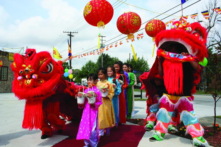 PHOTO BY CHUCK HOVEN Sunday, July 20, 2014; Celebration of 10th Anniversary of Quan Am Temple, 11921 Bellaire Road: Girls from the Quan Am Temple bring offerings of flowers to the Buddha during the ceremony: (Front to back): Lancy Nguyen, Rebecca McGinty, Lexie Lieu, Amanda To, Angela To, and Annie Nguyen.
