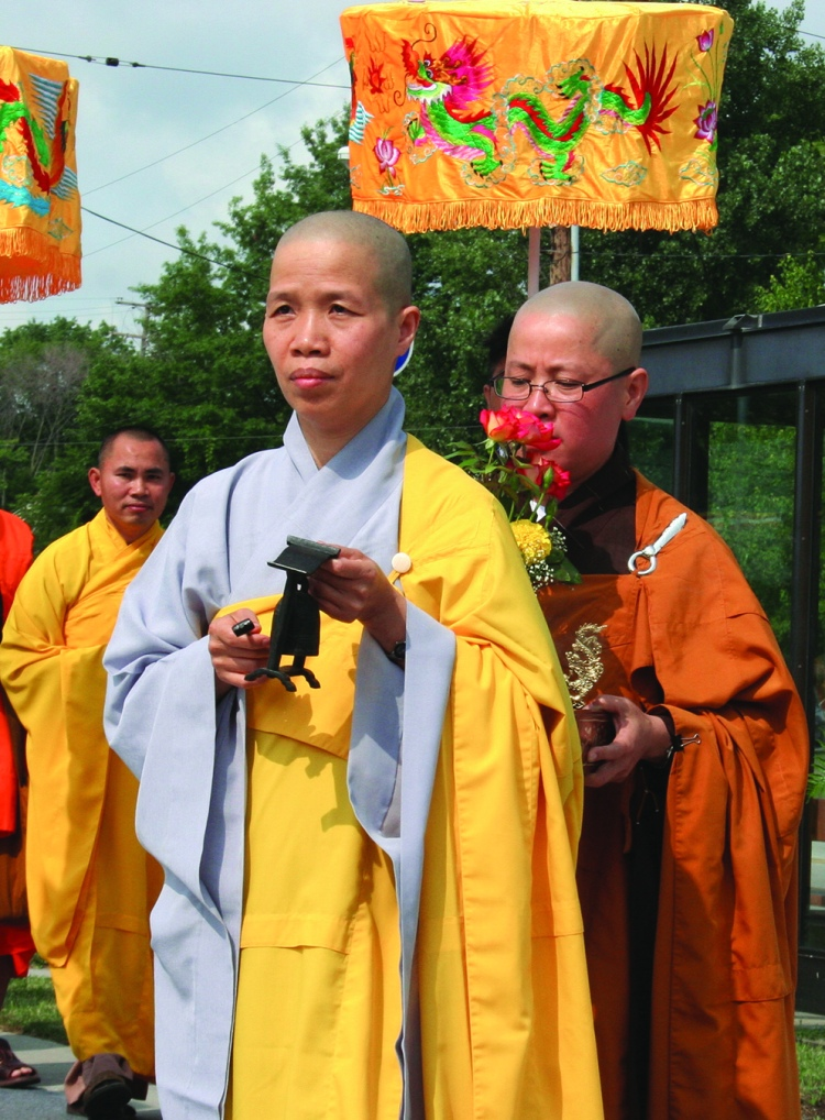 PHOTO BY CHUCK HOVEN Sunday, July 20, 2014; Celebration of 10th Anniversary of Quan Am Buddhist Temple, 11921 Bellaire Road: Buddhist nuns and monks walk in a procession from the temple to an outdoor tent where two hundred members and guests await their arrival to begin the celebration of the founding of the temple.