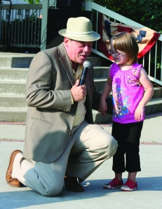 PHOTO BY CHUCK HOVEN Sunday, August 3, 2014; Westown Community Development Corporation Swinging' Summer Concerts at Halloran Park: Kayla Readinger, age 6, visits with Frank Sinatra (Damion Fontaine) as the Rat Pack entertains the crowd. Readlinger came up to the area in front of the gazebo to dance with Fontaine.