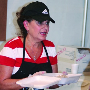 PHOTO BY CHUCK HOVEN Sunday, August 31, 2014; St. John Cantius Polish Festival, 906 College Ave: Caroline Sutowski serves up pierogies to guests at the festival.