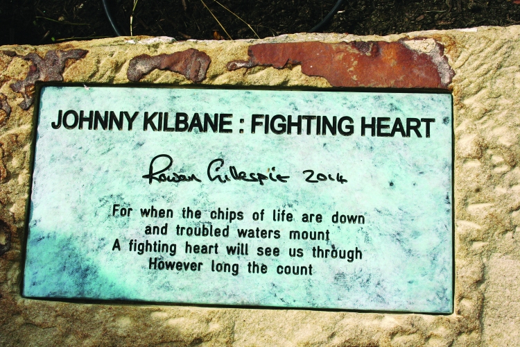 PHOTO BY ED TISHEL Sunday, September 28, 2014; The Irish American Archives Society's dedication of the Johnny Kilbane Sculpture and Plaza, W. 74th and Fr. Frascati Drive, Battery Park: The plaque by the sculpture at Battery Park reads: JOHNNY KILBANE: FIGHTING HEART, Rowan Gillespie 2014, For when the chips are down and troubled waters mount A fighting heart will see us through However long the count.