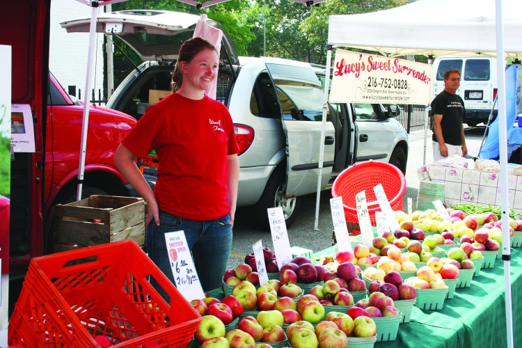 PHOTO BY DEBBIE SADLON Sunday, September 28, 2014; North Union Farmers' Market at Ohio City, United Building Parking Lot, 2012 W. 25th Street: Abby Woolf of Woolf Farms in East Rochester Ohio sells apples and cider.
