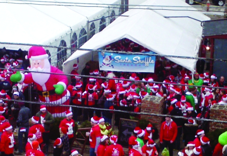 PHOTO BY HENRY SENYAK Saturday, December 13, 2014; Santa Shuffle, Tremont Tap House, 2475 Scranton Road: Runners dressed in Santa suites gathered outside the Tremont Tap House for the Santa Shuffle. The event, which helps to sponsor Tremont West Development Corporation's free community events, included a two-hour bar crawl, a one-mile race and a post race party.