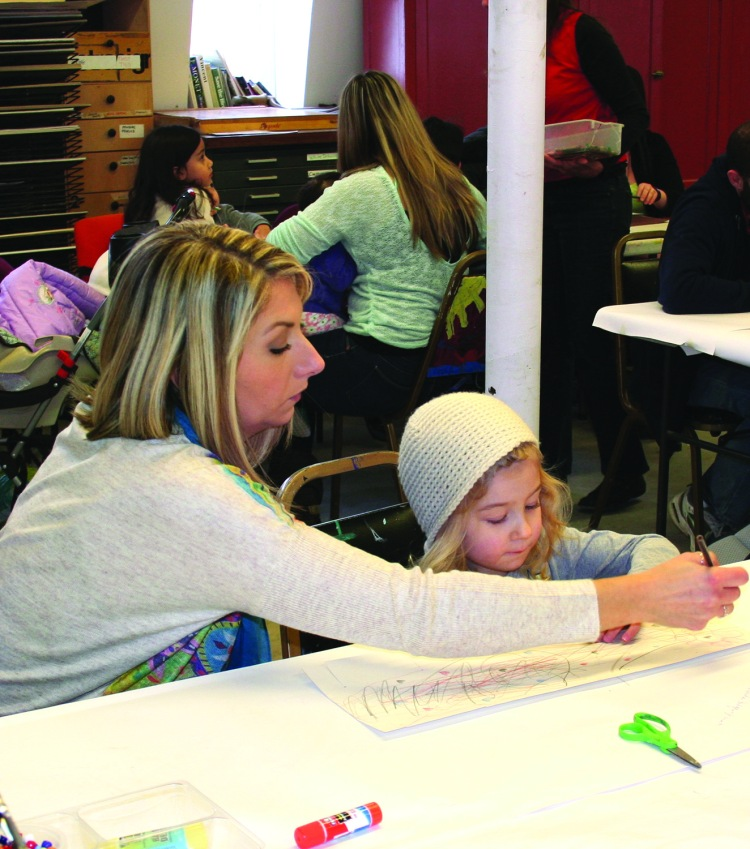 PHOTO BY DEBBIE SADLON Saturday, January 17, 2015; Family Open Studio at Art House, 3119 Denison Avenue: Karly Keirsey and her daughter Harper, age 3, work on an art project together. Art House holds a free Family Open Studio the third Saturday of each month from 1-3 p.m. Art House provides the materials for children accompanied by an adult to work on an art project.