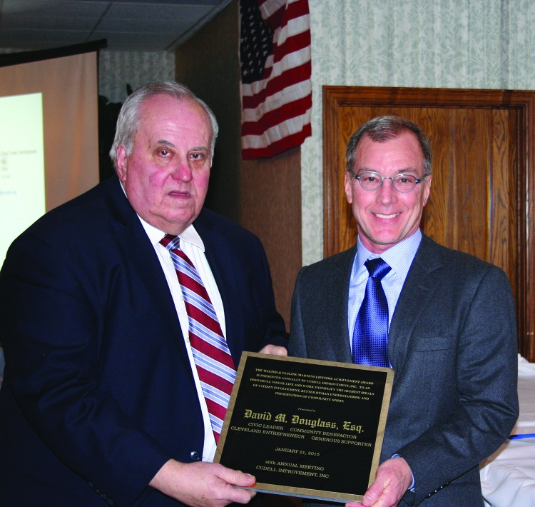 PHOTO BY CHUCK HOVEN Wednesday, January 21, 2015; Cudell Improvement's 40th Annual Meeting, Brennan's Banquet Center, 13000 Triskett Road: (L-R) In honor of his parents, Walter Martens Jr. presents David Douglas with the Walter & Pauline Martens Lifetime Achievement Award.  Douglas served as president of the West Boulevard Neighborhood Association in the early 1980s and wrote the grant for organizations recycling center. He also was involved over the years in assisting Simpson Methodist Church, St. Ignatius Church and Cudell Improvement. Cudell Improvement Executive Director noted Douglas' reputation as a successful debt collector for the City of Cleveland.