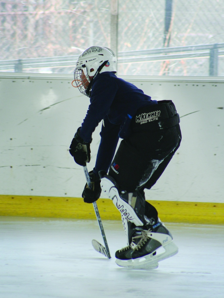 PHOTO BY DEBBIE SADLON Saturday, January 17, 2015; Halloran Park Skating Rink, 3550 W. 117th Street: Logan Helmick, age 13, a member of the Halloran Huskies Hockey Team, practices for an upcoming game.