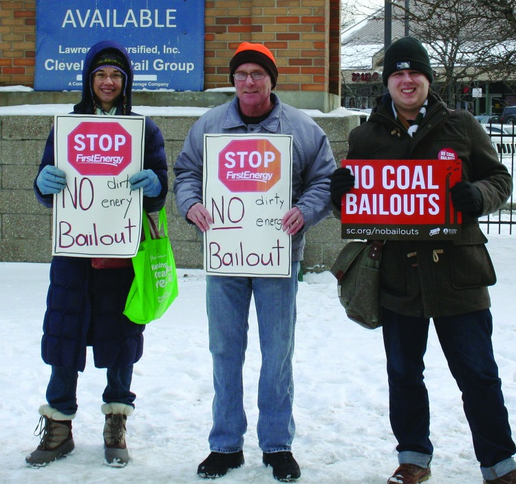 PHOTO BY DEBBIE SADLON Saturday, January 17, 2015; W. 25th and Lorain Avenue: (L-R) Emma Shook, Steve Holecko and Neil Waggoner protest First Energy's request to increase electricity rates to cover cost of continuing to use electricity from coal fired power plants. The protest occurred in advance of a Public Utilities Commission of Ohio hearing held on the First Energy request at Cleveland City Council's chambers on January 20th.