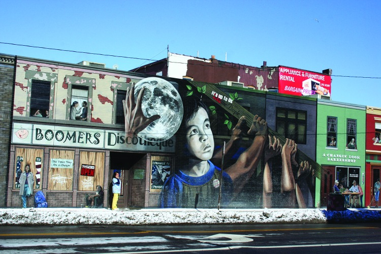 PHOTO BY CHUCK HOVEN Friday, February 20, 2015; Side of Medical office building on Clark Avenue at W. 25th Street: This mural, Its Up to Us by artist John Rivera-Resto, was cited by Clark Avenue planners as an example of what they would like to see more of in the La Villa Hispaña section of Clark Avenue