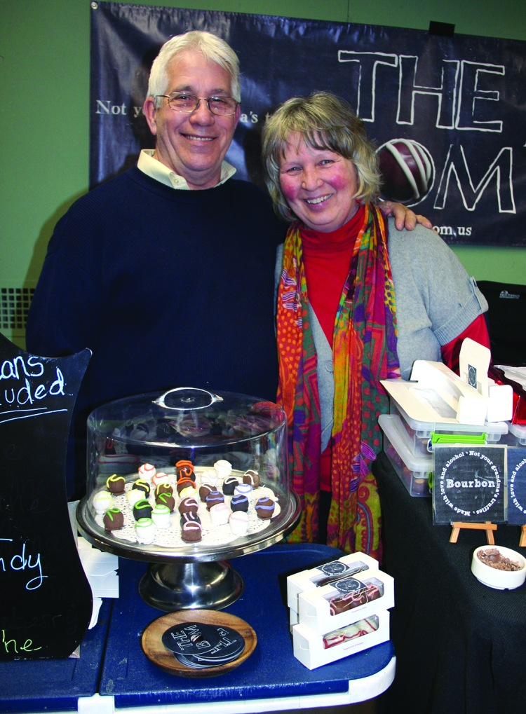 PHOTO BY CHUCK HOVEN Friday, February 20, 2015; Third Fridays at W. 78th Street Studios, W. 78th Street; North of Lake Avenue: Bill and Carolina Martin sell truffles made with love and alcohol at their stand – The BOM. The couple hopes rent a room for their shop in W. 78th Street Studios.