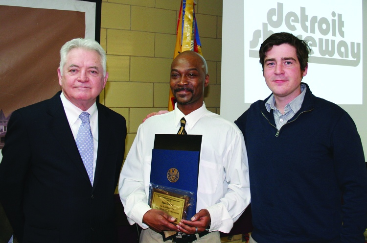 PHOTO BY CHUCK HOVEN Thursday, February 26, 2015; Detroit Shoreway Community Development Organization 41st Annual Meeting, Our Lady of Mt. Carmel Church Pope John Hall: (L-R) Cuyahoga County Council President Dan Brady presents a Neighborhood Improvement Award to Phil Hicks and Macklin Barry of Needs Cleveland at 7710 Lorain Avenue. The organization, started by Bill and Alison Ripcho of Ripcho Studio, offers clothing and other donated household items to Cleveland residents in need.