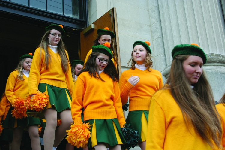 PHOTO BY DEBBIE SADLON Tuesday, March 17, 2015; St. Colman Church, 2027 W. 65th Street: Young women from the West Side Irish American Club emerge from St. Colman Church after the morning Mass and carefully descend the steps as they prepare to head downtown for the St. Patrick's Day Parade.