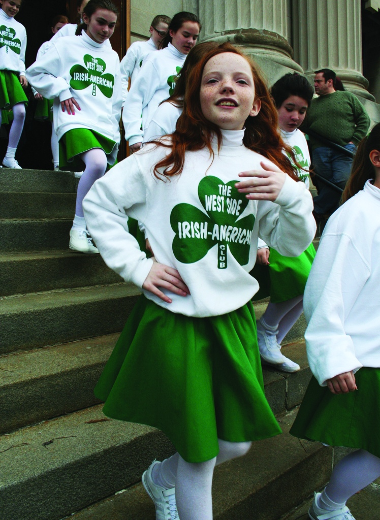 PHOTO BY DEBBIE SADLON Tuesday, March 17, 2015; St. Colman Church, 2027 W. 65th Street: Young members of the West Side Irish American Club come down the steps of St. Colman after Mass – ready to march in the St. Patrick's Day Parade on a cold and windy day in Cleveland.