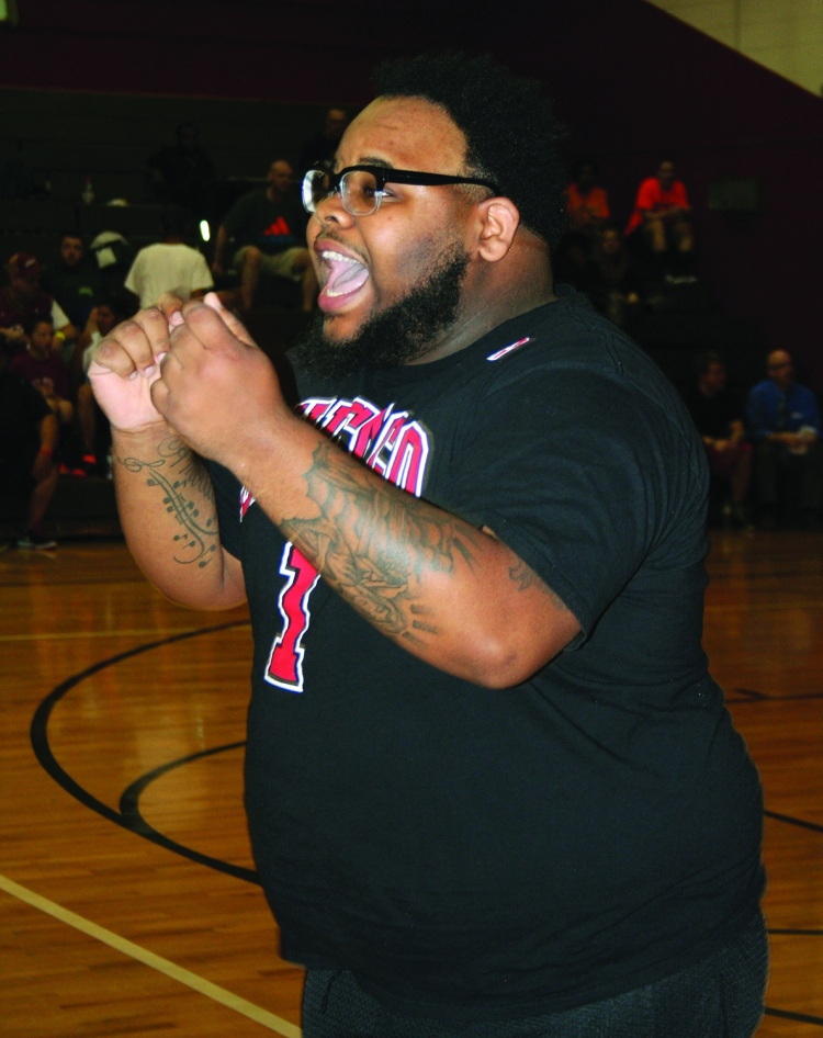 Saturday, April 18, 2015; Hoops for Children's Miracle Network, Luis Munoz Marin School gymnasium, 1701 Castle Ave: A fan cheers on his team in the three-on-three basketball tournament. Teams from area Walmarts entered the competition including five teams of players from the Steelyard Walmart.