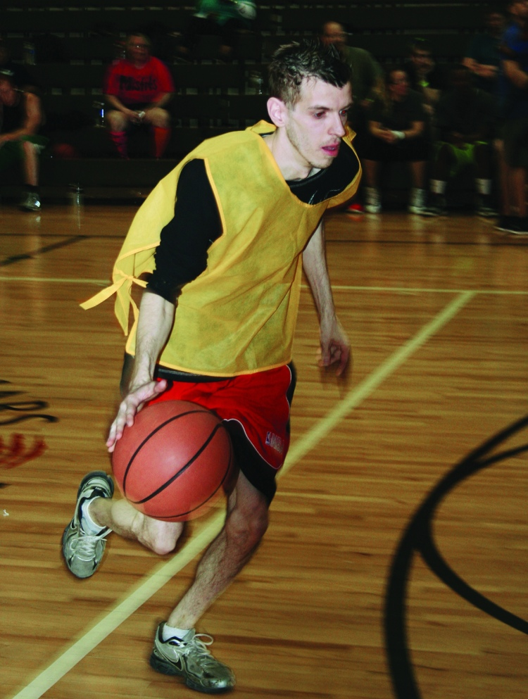 PHOTO BY DEBBIE SADLON Saturday, April 18, 2015; Hoops for Children's Miracle Network, Luis Munoz Marin School gymnasium, 1701 Castle Ave: A Walmart employee participates in a three-on-three basketball tournament to raise money for the Children's Miracle Network. The competition raised over $3,000 for the charity, which will directly benefit Rainbow Babies and Children Hospital patients and their families.
