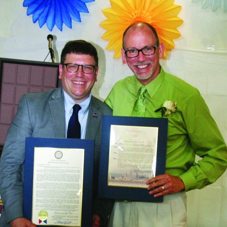 PHOTO BY DEBBIE SADLON Sunday, May 17, 2015; Reception and Luncheon for Pastor Allen V. Harris, Franklin Circle Church, 1688 Fulton Road: Ward 3 Councilman Joe Cimperman presents Rev. Allen Harris with a proclamation from the City of Cleveland honoring his 14 years of service to the community.