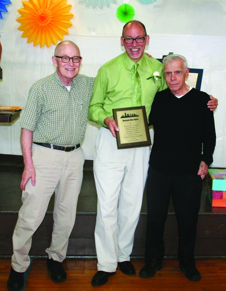 PHOTO BY DEBBIE SADLON Sunday, May 17, 2015; Reception and Luncheon for Pastor Allen V. Harris, Franklin Circle Church, 1688 Fulton Road: St. Patrick's Church Pastor Rev. Mark DiNardo (R) and Deacon Bill Merriman (L) present Rev. Allen Harris with a plaque from the Shared Ministry. Harris and Franklin Circle Church actively participated in Shared Ministry, which offers a variety of services to neighborhood residents.