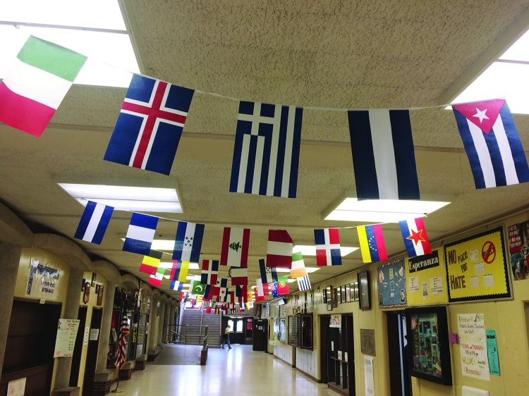 L-W's main hallway celebrates school diversity with flags from around the world.