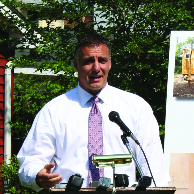 PHOTO BY DEBBIE SADLON Thursday, May 28, 2015; W. 58th Street and Pear Avenue: Joe DiRocco, President of Citizens Bank, Ohio talks about a donation of $140,000 by Citizens Bank toward the cost of building the first tiny house in Cleveland.