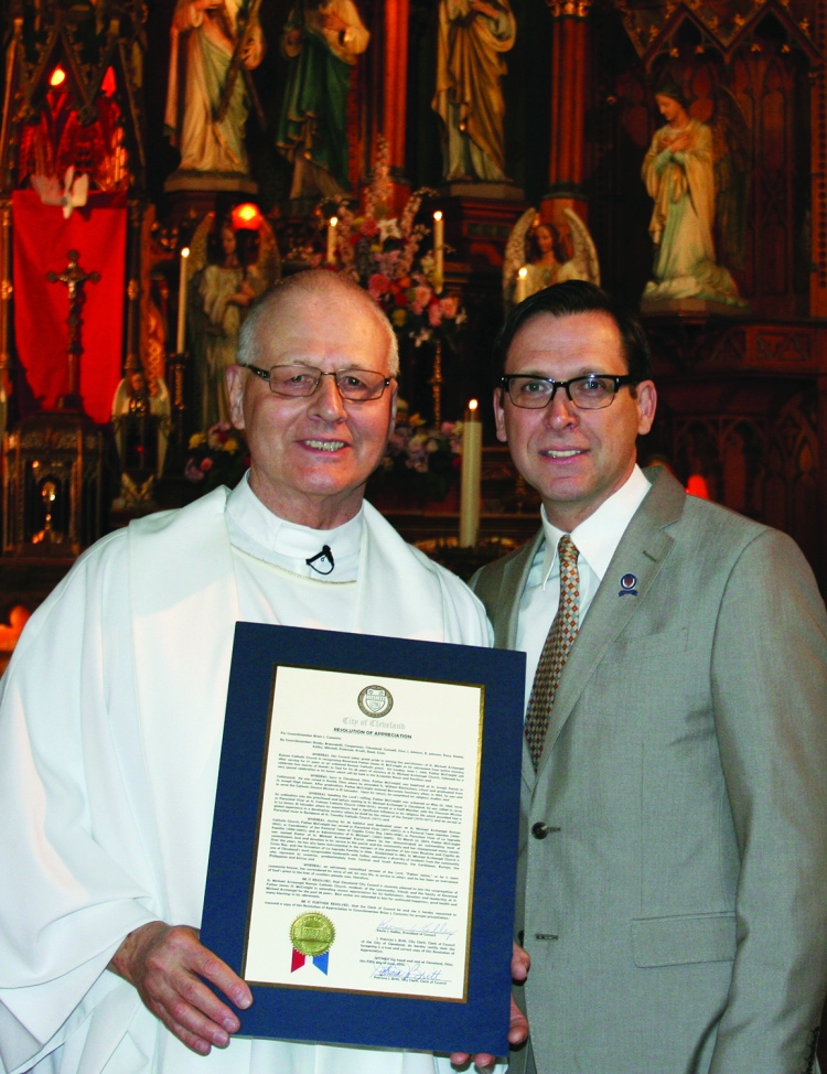 "PHOTO BY CHUCK HOVEN Sunday, June 7, 2015; St. Michael Archangel Parish, 3114 Scranton Road: Ward 14 Councilman Brian Cummins presents Reverend Father James McCreight with a proclamation from Cleveland City Council for his service to St. Michael's Parish. McCreight is retiring after 47 years as a priest – thirty-eight of those years were served at St. Michael's Parish, the last 12 as pastor. St. Michael's parishioners sang ""May the Lord always bless you and keep you"" at the Sundays masses and held receptions after the masses to offer Father McCreight best wishes for a happy retirement."