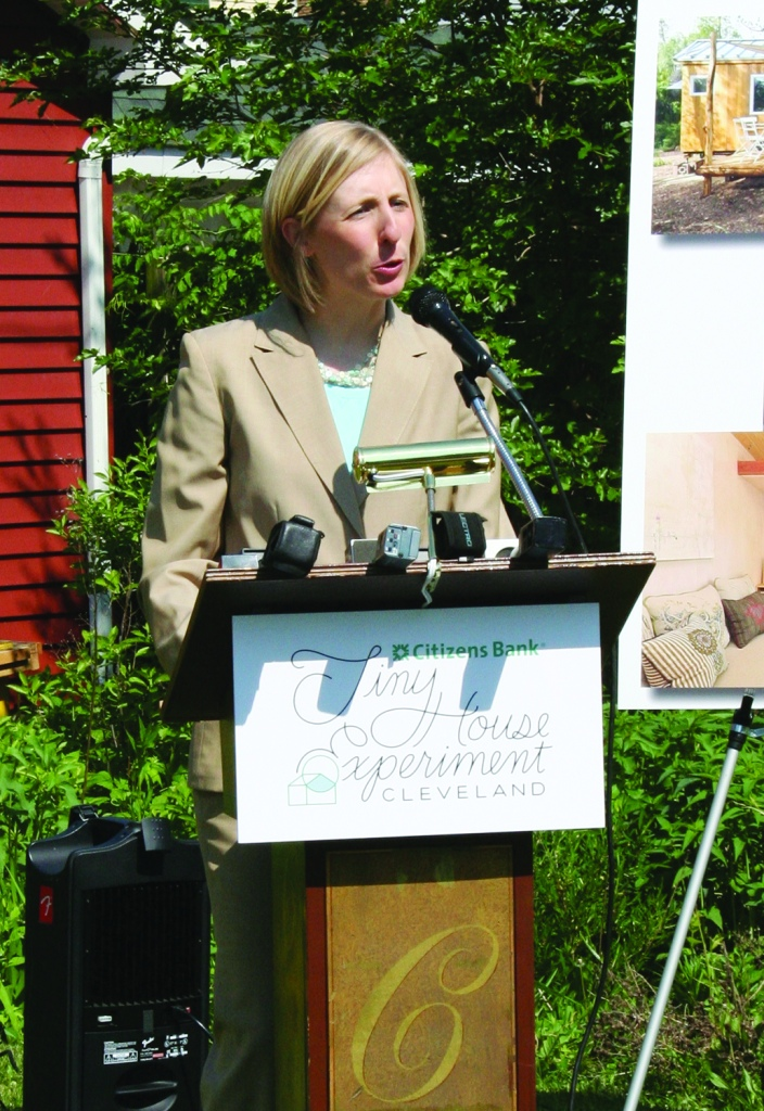PHOTO BY DEBBIE SADLON Thursday, May 28, 2015; W. 58th Street and Pear Avenue: Jenny Spencer, Managing Director of Detroit Shoreway Community Development Organization welcomes the Tiny House movement to the EcoVillage in the Detroit Shoreway neighborhood. She says the green built energy efficient houses will allow people to live on one floor while they age in place.