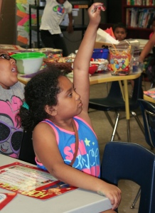 PHOTO BY DEBBIE SADLON Tuesday, July 21, 2015; Boys and Girls Club Walton School Site, 3409 Walton Ave: Dortha Montgomery raises her hand, eager to answer a question from Instructor Shirlann Lawson about the meaning of a sentence.