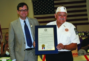 PHOTO BY CHUCK HOVEN Saturday, July 18, 2015; Vietnam War Commemorative Partner Ceremony, VFW 2850 Meeting Hall, 3296 W. 61st Street: VFW Post 2850 Commander Ray Diaz accepts a copy of a City Council Resolution from Ward 14 Councilman Brian Cummins. The ceremony honored those that served in Vietnam -- the living and the fallen -- fifty years after the beginning of the United State's involvement in the conflict.
