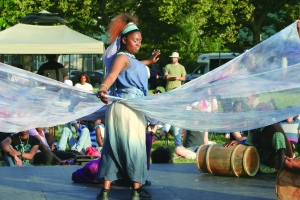 PHOTO BY DEBBIE SADLON Tuesday, August 4th, 2015; Cleveland Public Theatre's Student Theatre Enrichment Program performance of an original new play, Lost in the Water, Herman Park, W. 58th and Herman Avenue: Dezbezisa, the River Goddess (portrayed by Dezhanay Simmons) rewards Selekana (portrayed by Tasheania Lee) with gifts for her good deeds.