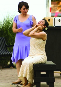 PHOTO BY CHUCK HOVEN Sunday, August 2, 2015; Cleveland Shakespeare Festival performance of The Merchant of Venice, Arts in August, free art programming in Tremont's Lincoln Park: Portia (portrayed by Faith Whitacre) shares her hopes with her maid in waiting, Nerissa (portrayed by Hillary Wheelock) that her favorite suitor, Bassanio, will pass the test designed by her father for those seeking her hand in marriage