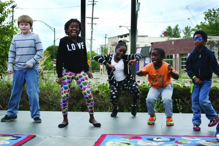 PHOTO BY DEBBIE SADLON Saturday, September 12, 2015; the Bridge Beats and Treats Festival, West Side Community House, 9300 Lorain Avenue: A group of children demonstrate their dance skills on stage.