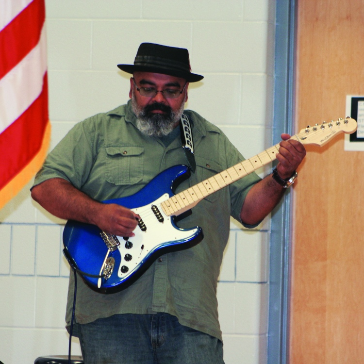 PHOTO BY DEBBIE SADLON Monday, August 31, 2015; Max S. Hayes High School Ribbon Cutting Ceremony, 2211 W. 65th Street: Musician Austin Walkin' Cane plays a guitar designed, built and painted by Max Hayes students.
