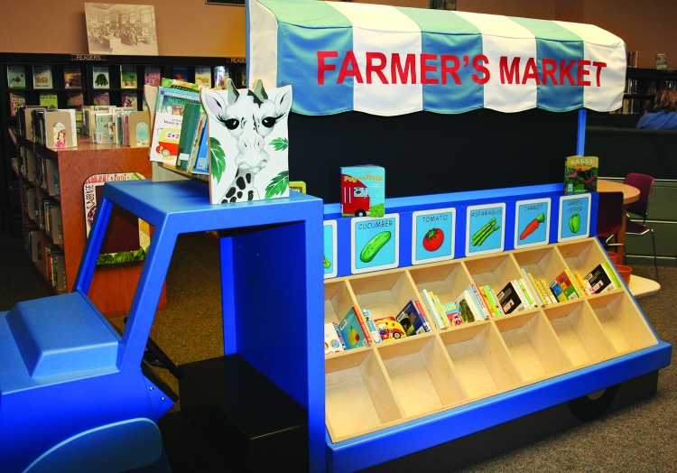PHOTO BY DEBBIE SADLON Saturday, September 12, 2015; Carnegie West Library's Family Learning & Literacy Play Space, 1900 Fulton Road: The Farmer's Market Truck with open boxes awaiting vegetables harvested from the garden.