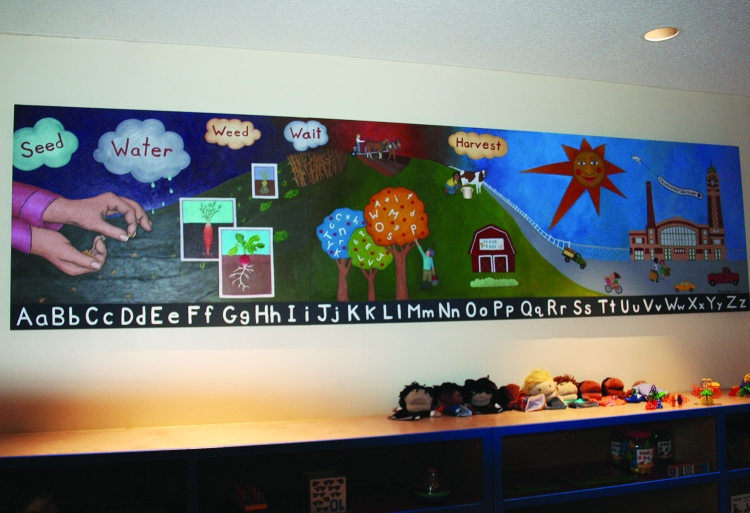 PHOTO BY DEBBIE SADLON Saturday, September 12, 2015; Carnegie West Library's Family Learning & Literacy Play Space, 1900 Fulton Road: A new mural by Cleveland artist Jamilla Naji now adorns the wall in the library's toy room.