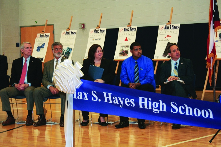 PHOTO BY DEBBIE SADLON Monday, August 31, 2015; Max S. Hayes High School Ribbon Cutting Ceremony, 2211 W. 65th Street: (L-R) United States Senator Rob Portman, Cleveland Mayor Frank Jackson, Max Hayes Principal Kelly Wittman, Max Hayes Student Malik Mims, and Cleveland Ward 15 Councilman Matt Zone listen as speakers talk about the opening of the new Max Hayes, and the opportunities it will offer for students.