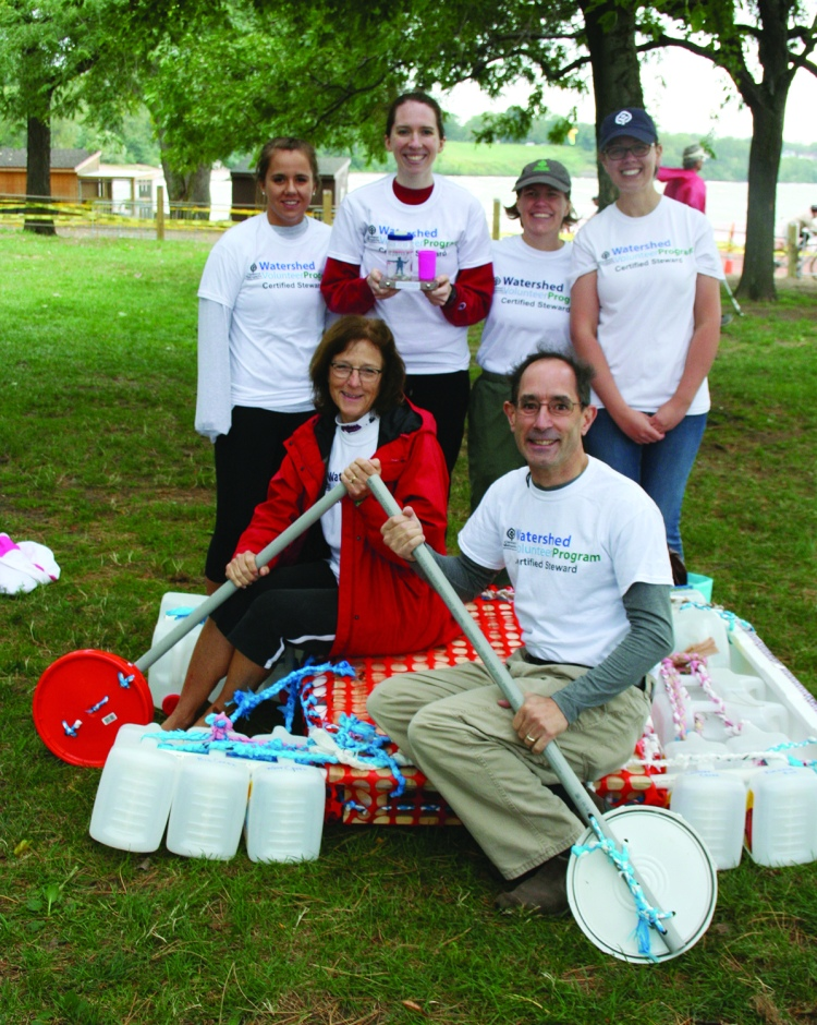 PHOTO BY DEBBIE SADLON Saturday, September 12, 2015; Great Lake Erie Boat Float, Edgewater Park: The award for best use of recycled and repurposed materials went to the builders of A Watershed Moment. The team used plastic kitty litter bottles held together with braded plastic bag rope to help float a pallet. Their oars were made from the lids of large plastic tubs. Team members are: (Front row): Carrie Hansen and David Saja. (Rear): Erin Tesny, Maggie Kane, Leila Jackson and Megan Smith. Not shown: Ellen Brown-Armstrong.