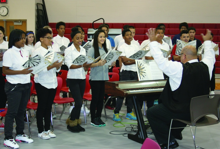 PHOTO BY DEBBIE SADLON Thursday, September 24, 2015; John Marshall High School Ribbon Cutting Ceremony, 3952 W. 140th Street: Members of the John Marshall Choir add their voices to the celebration of the opening of their new school.