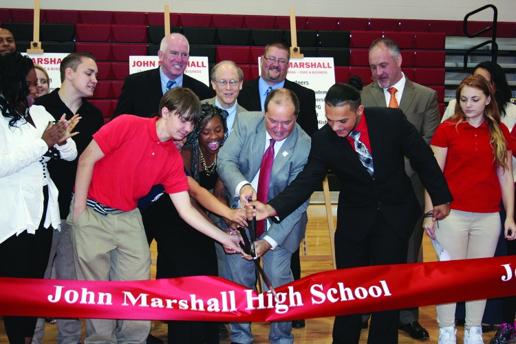PHOTO BY DEBBIE SADLON Thursday, September 24, 2015; John Marshall High School Ribbon Cutting Ceremony, 3952 W. 140th Street: Cleveland Metropolitan School District Chief Executive Officer Eric Gordon joins with 12th grade students Da'Jzhanae Smith and Kevin Gramajo to cut the ribbon.