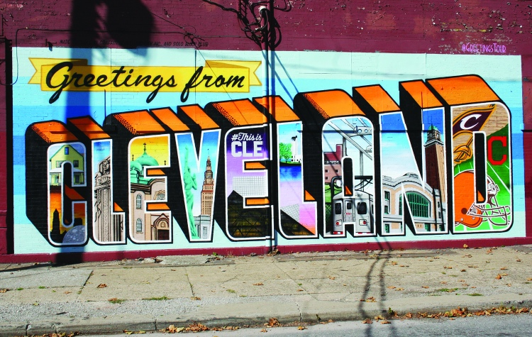 PHOTO BY CHUCK HOVEN Thursday, October 15, 2015; Greetings from Cleveland Mural, W. 25th and Chatham: This mural represents a collaboration between New York City graffiti artist Victor Ving, Ohio photographer Lisa Beggs and local artists. Ving and Beggs travel around the country in a RV designing murals inspired by vintage postcards. The SOLO Block Club, Ohio City Inc., Graffiti HeArt and Destination Cleveland sponsored the mural.