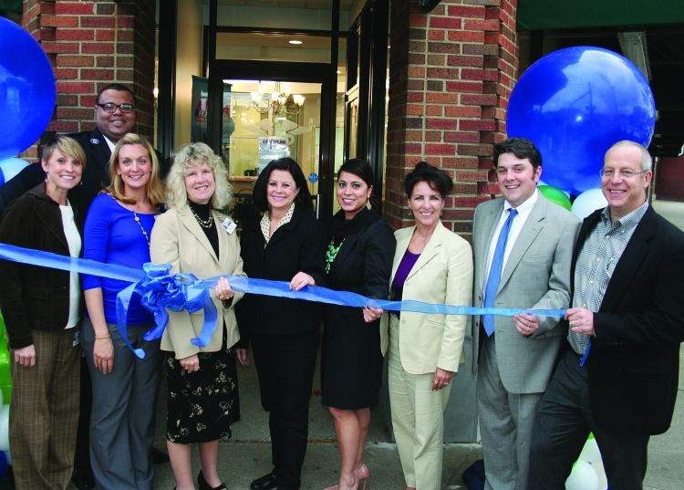 PHOTO COURTESY OF NEIGHBORHOOD FAMILY PRACTICE Tuesday, October 13, 2015; Ribbon Cutting for Neighborhood Family Practice's new W. 117th community health center, 11709 Lorain Avenue: Cutting the Ribbon are: (Left to Right) Shanna Gnew, RN, NFP W 117th Community Health Center; Cameron Helmick, NFP Patient and Community Partner; Melanie Golembiewski, MD, NFP W. 117th Community Health Center; Jean Polster, CEO, Neighborhood Family Practice; Councilwoman Dona Brady, Ward 11; Toinette Parrilla, Director, Department of Public Health; Rose Zitiello, Executive Director, Westown Community Development Corporation; Tom Gill, Board President, Neighborhood Family Practice; and Erick Kauffman, MD, CMO, Neighborhood Family Practice.