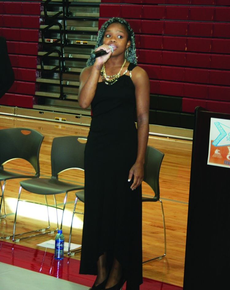PHOTO BY DEBBIE SADLON Thursday, September 24, 2015; John Marshall High School Ribbon Cutting Ceremony, 3952 W. 140th Street: 12th grade student Da'Jzhanae Smith sings the Star Spangled Banner.