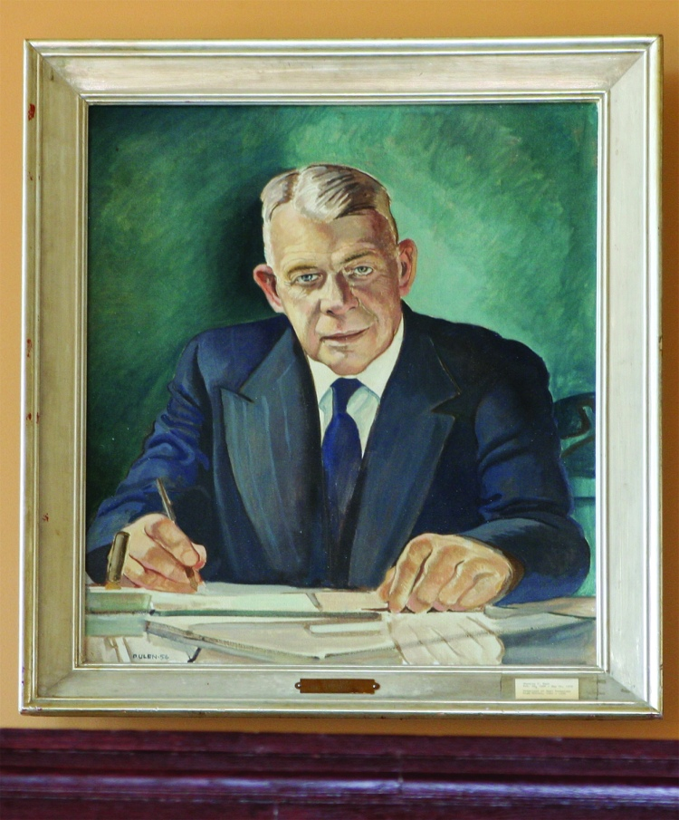 PHOTO BY DEBBIE SADLON Thursday, October 15, 2015; West Tech Alumni Association Museum, Auditorium Balcony, 2201 W. 93rd: The portrait of legendary West Tech Principal Charles Cecil Tuck looks down on the museum from the balcony. Tuck, who arrived at West Tech in 1924, served as the high school's principal for 34 ½ years.