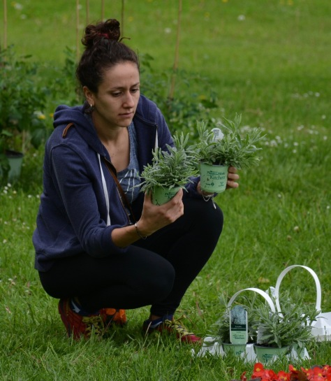 Gabi Andrada examines some herbs.