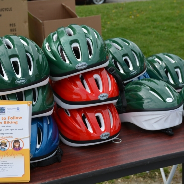 Stacks of different colored bicycle helmets wait to be fitted.