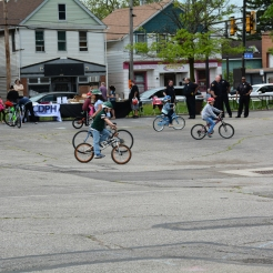 Police Officer's from Cleveland's 2nd District watch as neighborhood children enjoy the comfortable weather during the bike-a-thon.